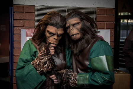 a picture of some cosplay characters in planet of the apes atire