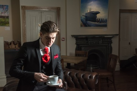 Bonafide images burnley wedding photographer - groom enjoying a cup of tea before the wedding